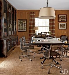 Azaria keeps his Emmys and memorabilia in his home office, where Eames chairs by Herman Miller surround the custom-designed poker table and pendant lamps. The bespoke metal cabinet at left is by Bourgeois Bohème Atelier, and the curtains are made of a plaid alpaca fabric by Sandra Jordan.