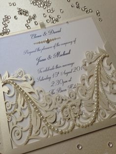 Vintage pocket Ivory pearl wedding invitation with pearl embellishments hand made by Crafty Designer