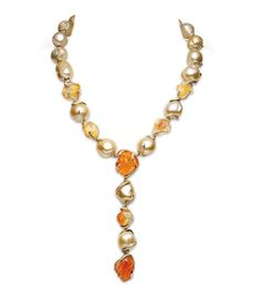 Phoenix Necklace is a magnificent piece featuring rare Baroque Golden South Sea cultured pearls, tumbled fire opals and diamonds set in yellow gold - Mikimoto at BaselWorld