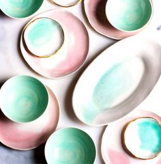 Watercolours and gold lines on this beautiful service in mint and light pink.