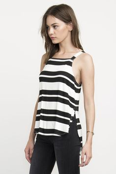 The RVCA Memoir is a knit, straight cut tank with self straps and high slits at the side seams. The top includes a RVCA solo label at the center back.