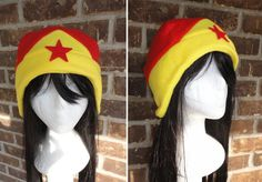 Awesome Wonder Woman Hat by ~akiseo on deviantART Convert to crochet graph - work sideways (like Spiderman beanie for Aiden).  Make star an applique.