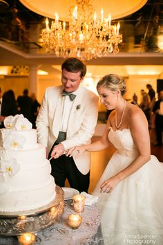 Bride and groom cutting the cake at their 103 West wedding reception