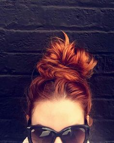 Master the messy bun with @StyleCaster's hair inspiration roundup | high topknot red hair