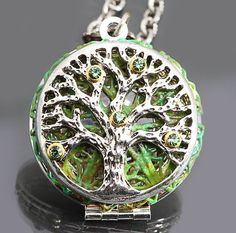 Tree of life necklace with shades of green filigree.  Erinite crystals accent the tree of life locket.  A working compass inside the locket helps point you in the right direction.  Great holiday gift. Compass necklace by DesignsBloom on Etsy.  44.99