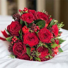 Deep red seasonal wedding flowers for a winter wedding