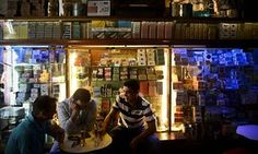 People sit at the traditional canned fish bar Sol e Pesca at Cais do Sodre in Lisbon, Portugal