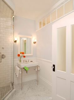 Bath door idea remove top 2 panels ..  add frosted glass     Small bathroom with a big look. Charlie Allen Restoration.