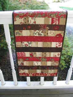 Jellyroll quilted table runner...love the colors would make a great large quilt