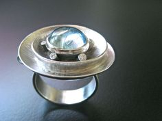 Dramatic Oval Spiral Ring/Pendant  In 14k white gold with customer's large aquamarine cabochon surrounded by tapering sized bezel set white diamonds, commissioned in 2010, Topsfield MA
