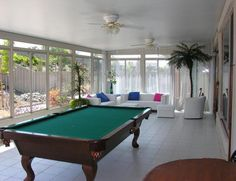 amazing-patio-rooms-with-modern-interior-decorating-plus-billiard-table-and-white-sofa