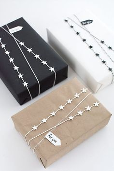 Neutral wrapping idea with mini star garland ribbon for Christmas