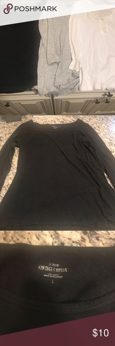 Lot of 3 j.Crew long sleeve t shirts tops large Lot Of 3 j.Crew tops with defects. Black vintage cotton top has bleach marks on the back. I always wore it with a cardigan so it's not noticeable. Gray top has red stains on the back (probably another top bled onto it). The white top has a small hole. All defects are pictured. All size large J. Crew Tops Tees - Long Sleeve