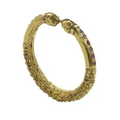 An Antique Gold and Ruby Bangle Bengal 19th Century A gold repousse bangle inset with rubies of the type worn by bridegrooms. www.ollemans.com SOLD