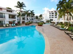 Boasting impeccable gardens and recently refurbished buildings that evoke a traditional Mexican village, The Royal Cancun offers the perfect family hideaway. Book private transportation now! Cancun Hotel Zone, Cancun Resorts, Airport Transportation, Lodges, Tours, Outdoor Decor, Buildings, Mexican, Gardens
