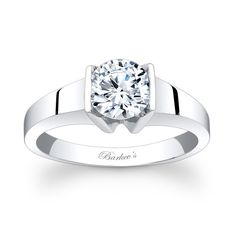 Solitaire Engagement Ring - 7823LW - Stunning, bold styling this solitaire engagement ring features a low profile bright polished white gold shank, set with a channel set round diamond center.      Also available in yellow gold, 18k and Platinum.
