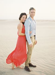 I love this unusual men's jacket, and this red flowy dress. Perfect for creating engagement photos that stand out against clean landscapes like the beach.