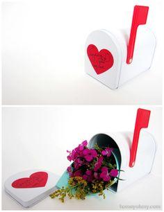 Flowers in a mini mailbox.  Cute Valentine's Day idea.