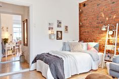 Studio apartment with exposed brick wall