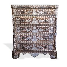 Here is a great example of the fine Syrian wedding dresser inlaid with mother of pearl and camel bone on walnut. A real niece and decorative piece.