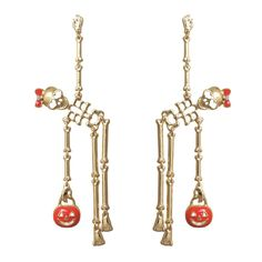 Gold color dangle earrings with orange enamel accents Festive dancing skeletons wearing little orange bows Post drop earrings; inch length and inch width Get in the Halloween spirit with these fun earrings! Packaged in a gift box White Gold Bridal Jewellery, Bridal Jewelry, Minimalist Earrings, Minimalist Jewelry, Gold Bar Earrings, Drop Earrings, Green Gemstones, Women Halloween, Halloween Fashion