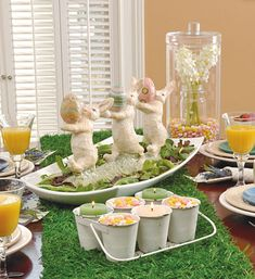 Rest a springy figurine, such as these marching bunnies, on a serving platter, and then spread lettuce, spinach or aptly named spring mix around the base.