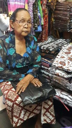 A batik seller at Beringharjo Market in Jogjakarta,Central Java