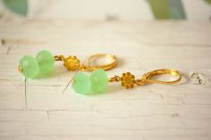Items similar to Christmas Jewelry Mint Green Faceted Glass Bead Golden Earrings with Little Golden Flower, Elegant Golden Earrings, Mint Earrings on Etsy Mint Earrings, Golden Earrings, Stud Earrings, Faceted Glass, Glass Beads, Jewelry Crafts, Handmade Jewelry, Twist Weave, Golden Flower