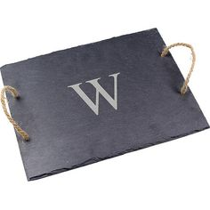 Practical and decorative, this slate serving tray is finished with hemp handles and custom personalization. Product: Serving ...