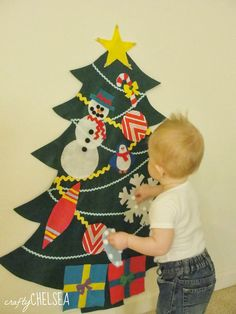 Life With My Littles: The Best Way to Make a Felt Christmas Tree -- I'm definitely doing this for the twins first Christmas.