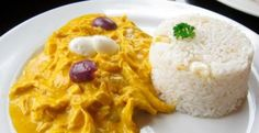Aji de gallina is a delicious Peruvian classic—slightly spicy and bright yellow from the famous aji amarillo peppers, and rich from the unusual cream sauce made with ground walnuts Peruvian Recipes, Food Dishes, Hummus, Macaroni And Cheese, Spicy, Stuffed Peppers, Ethnic Recipes, Traveling Tips, Bright Yellow
