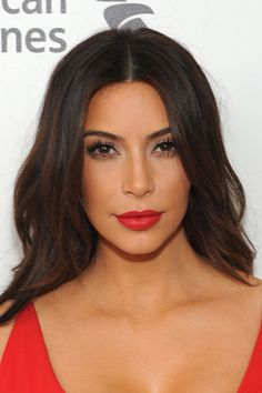 Ditching her signature nude, Kim mixes her look up with a matching scarlet red lip and dress combination, perfectly lined and crisp this makes her lips look fuller and attention grabbing.