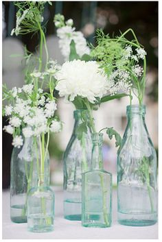 Old bottles with fresh garden flowers is such a simple and inexpensive way to bring spring freshness into every part of your home!