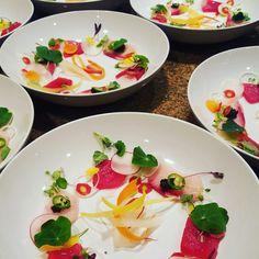 Tuna and hamachi crudo, nasturtium, citrus leaves, carrot, radish, serrano, sturgeon caviar, citrus oil