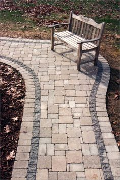The bench pictured here makes the perfect compliment to this Unilock brussles limestone paver walkway, laid in a random mixed pattern.