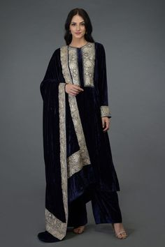 """From """" NOOR"""", our new collection of Kashmiri tilla embroidery adorned silk velvets, this midnight blue silk velvet kurta is adorned with silver Tilla embroidery paired with silk velvet tilla embroidered dupatta and silk velvet lowers. Stylish Dress Designs, Stylish Dresses, Casual Dresses, Fashion Dresses, Velvet Suit Design, Velvet Dress Designs, Blue Velvet Dress, Velvet Dresses, Party Wear Dresses"""