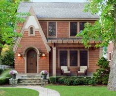 This 1927 English-style cottage had great lines but no curb appeal until its owner added a front porch pergola, prestained western red cedar shingles, composite stucco, and layers of composite trim painted in Sherwin-Williams's Spalding Gray. Check out the transformation here. | thisoldhouse.com