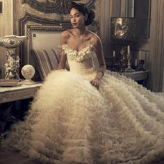 Oscar De La Renta .....Love Love Love this dress, Oscar De La Renta ha recently been named the most expensive in fashion wear.