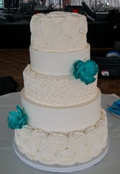 Christina & Josh's white w/turquoise flower wedding cake from Lovin Oven Cakery