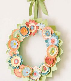 This is a paper wreath, but how cute would it be in felt and printed fabric with frayed edges? Then you'd have a little dimension. Welcome Spring!