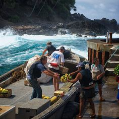 A longboat is loaded to take supplies and passengers to a nearby freighter offshore of remote Pitcairn Island. Coastalliving.com
