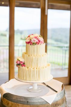 7095d3e79af Love Wedding Cakes The white chocolate rolls seem like an easy way to make a  homemade cake look elegant.