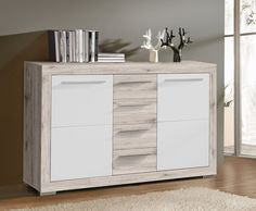 Verschaffen Sie sich durch dieses Sideboard zusätzlichen Stauraum in Ihrem Wohnzimmer. Sideboard Sandeiche/ weiss hochglanz 77-00446