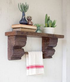 """Dimensions: 27"""" x 7"""" x 10.5""""t Recycled wooden shelf with antique corbels. The carving details are exquisite! the towel bar makes this shelf perfect for a bathroom or kitchen."""