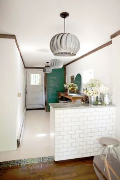 Chalkboard wall, subway tile kitchen. Are these roof vents a pendant lights?