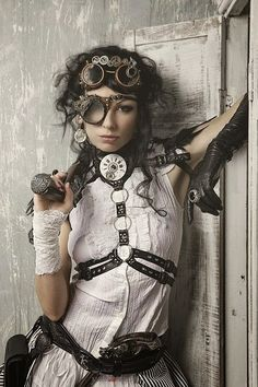 Accessorized steampunk girl: belt, blouse, earrings, epaulets, eyepatch, gloves/gauntlets/cuffs/bracers, goggles, gun, leather harness, prop, ring, womens clothing