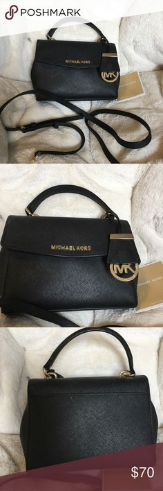 Michael kors small black purse. Michael kors small black purse. I got it as a Christmas present. Not really my style bag. Comes with a care card and what is left of the tag since it was a Christmas present. And a strap so you can hang it from your shoulder. All will and is in bag. Will negotiate price I am asking for. Michael Kors Accessories