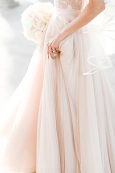 Layers of romance. Sara Gabriel's Phoebe Veil adds the finishing touch to this look.  An ivory veil with blush is perfect.  The Phoebe Veil is a Cascade Veil finished with horse hair trim helps the veil hold its shape.