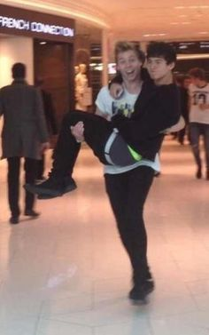 LUKE LOOKS SO FRIGGEN HAPPY AND THEN CAL JUST LOOKS MAD