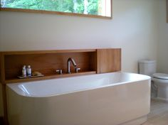 """built in storage for a bath that is free standing.  Genius.  Then you don't have to see all the """"stuff"""".  MUST."""